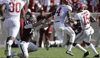 Alabama 's Eddie Jackson (4) runs past Texas A&M quarterback Kyle Allen (10) as he returns an interception for a touchdown during the first half of an NCAA college football game, Saturday, Oct. 17, 2015, in College Station, Texas. (AP Photo/Eric Gay)