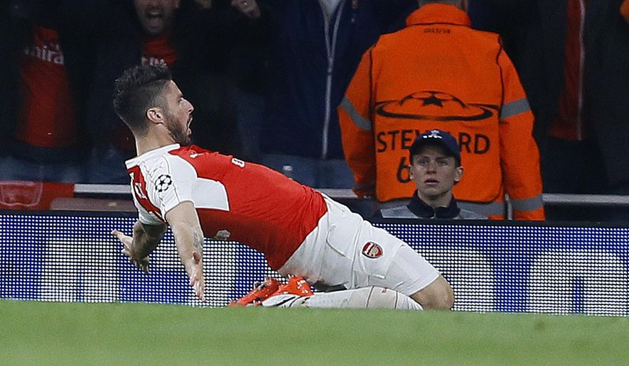 Arsenal's Olivier Giroud celebrates after scoring during the Champions League Group F soccer match between Arsenal and Bayern Munich at Emirates stadium in London Tuesday, Oct. 20, 2015. (AP Photo/Kirsty Wigglesworth)