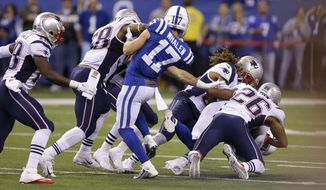 FILE - In this Oct. 18, 2015, file photo, Indianapolis Colts wide receiver Griff Whalen (17) watches as Colts free safety Colt Anderson (32) is tackled by New England Patriots running back James White (28) on a fake punt in the second half of an NFL football game in Indianapolis. (AP Photo/AJ Mast)