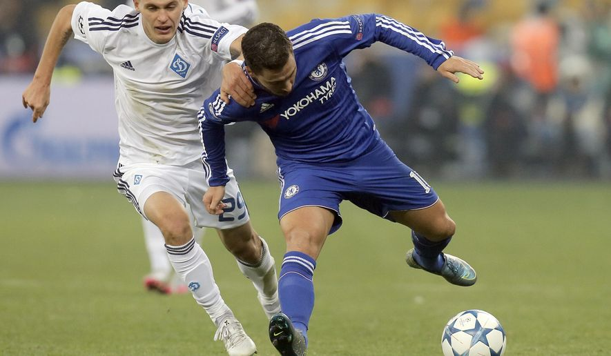 Kiev's Vitaliy Buyalskiy, left, challenges for the ball with Chelsea's Eden Hazard during the Champions League Group G soccer match between Dynamo Kiev and Chelsea at the Olympiyskiy Stadium in Kiev, Ukraine, Tuesday, Oct. 20, 2015. (AP Photo/Efrem Lukatsky)