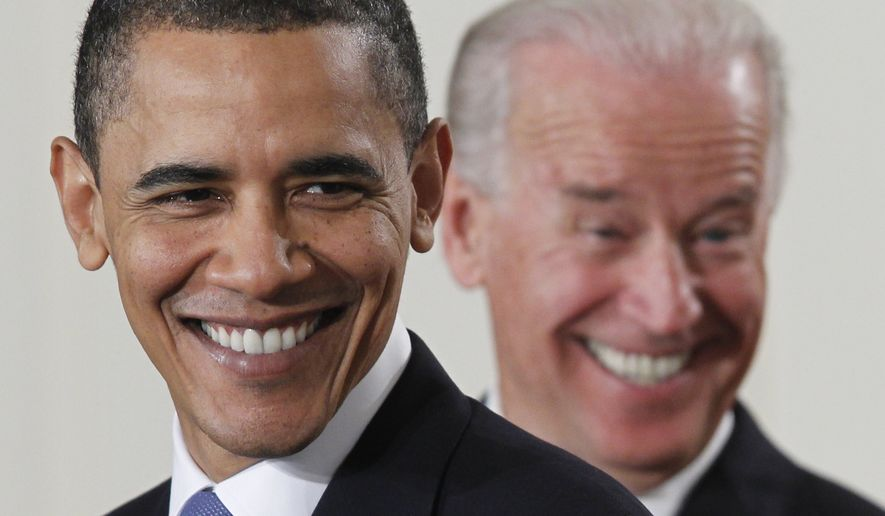 President Barack Obama and Vice President Joe Biden smile in the East Room of the White House in Washington, Tuesday, March 23, 2010, before the president signed the health care bill. (AP Photo/Charles Dharapak)
