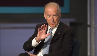 Vice President Joe Biden speaks Oct. 20, 2015, at George Washington University in Washington during a forum honoring the legacy of former Vice President Walter Mondale. (Associated Press) ** FILE **
