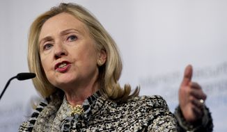 Hillary Rodham Clinton's State Department initially approved a weapons shipment from a California company to Libyans seeking to oust Moammar Gadhafi in 2011 even though a United Nations arms ban was in place, according to memos recovered from the burned-out compound in Benghazi. (Associated Press)