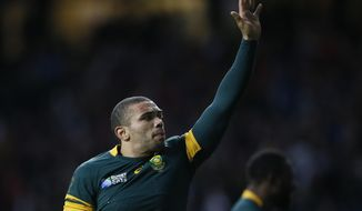 South Africa's Bryan Habana waves to the crowd after the Rugby World Cup quarterfinal match between South Africa and Wales at Twickenham Stadium, London, Saturday, Oct. 17, 2015. South Africa won the match 23-19. (AP Photo/Kirsty Wigglesworth)