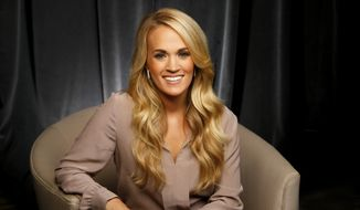 "In this Sept. 28, 2015 photo, Carrie Underwood poses for a portrait at Sony Music Nashville in Nashville, Tenn., to promote her latest album, ""Storyteller."" (Photo by Donn Jones/Invision/AP)"