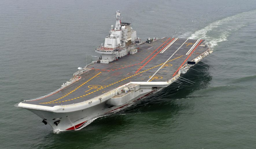 """FILE - In this May 2012 file photo provided by China's Xinhua News Agency, Chinese aircraft carrier Liaoning cruises for a test on the sea.  China this week hosted a visit to its sole aircraft carrier by senior U.S. Navy officers amid tensions over reported plans by Washington to challenge Beijing's territorial claims in the South China Sea.  The delegation of 27 commanders and captains boarded the Liaoning on Monday, Oct. 19, 2015,  and held discussions on """"exercise management, personnel training, medical protection and strategies in carrier development,"""" the Chinese navy said on its official microblog.  (Li Tang/Xinhua via AP, File) NO SALES"""