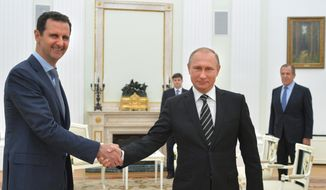 In this photo taken on Tuesday, Oct. 20, 2015, Russian President Vladimir Putin, center, shakes hand with Syrian President Bashar Assad as Russian Foreign Minister Sergey Lavrov, right, looks on in the Kremlin in Moscow, Russia. (Alexei Druzhinin, RIA-Novosti, Kremlin Pool Photo via AP)