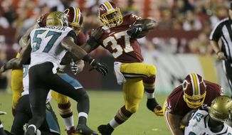 Washington Redskins running back Mack Brown (37) carries the ball during the second half of an NFL preseason football game against the Jacksonville Jaguars in Landover, Md., Thursday, Sept. 3, 2015. (AP Photo/Mark Tenally)
