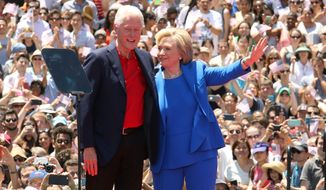 Newly released emails from the conservative group Citizens United show that the business of Hillary Clinton's State Department and the business of former President Bill Clinton were often intertwined. (Associated Press)