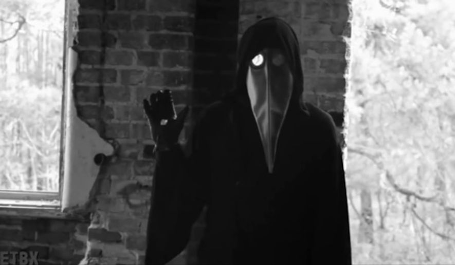 A masked figure is featured in a cryptic and chilling online video that many on social media believe could be a terrorist threat to U.S. President Barack Obama. (Image: Screen grab YouTube)