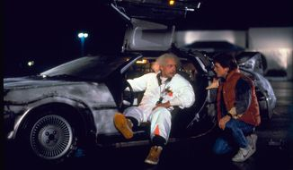 "This photo provided by Universal Pictures Home Entertainment shows Christopher Lloyd, left, as Dr. Emmett Brown, and Michael J. Fox as Marty McFly in the 1985 film, ""Back to the Future."" Wednesday's so-called ""Back to the Future"" Day marks the date - Oct. 21, 2015 - that characters McFly, Brown and Jennifer Parker famously journeyed to the future in the film trilogy's second installment in 1989. ""The Back to the Future 30th Anniversary Trilogy"" and ""Back to the Future: The Complete Adventures"" release on Blu-ray and DVD on Oct. 20. (Universal Pictures Home Entertainment via AP)"