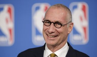 In this Oct. 6, 2014, file photo, ESPN President John Skipper smiles during a news conference in New York. (AP Photo/Mark Lennihan) ** FILE **