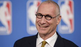 "FILE - In this Oct. 6, 2014, file photo, ESPN President John Skipper smiles during a news conference in New York. Disney's ESPN on Wednesday, Oct. 21, 2015 confirmed it is cutting about 300 jobs, or 4 percent of its staff, amid signs that the traditional cable bundle is less far-reaching than it once was. Skipper says, in a memo to employees that was posted online, these cuts are part of changes being made to keep ESPN as the ""premier sports destination on any platform."" (AP Photo/Mark Lennihan, File)"