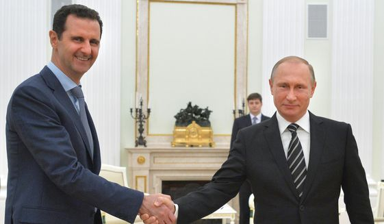 In this photo taken on Tuesday, Oct. 20, 2015, Russian President Vladimir Putin, right, shakes hand with Syria President Bashar Assad in the Kremlin in Moscow, Russia. Assad has traveled to Moscow in his first known trip abroad since the war broke out in Syria in 2011 to meet his strongest ally Russian leader Vladimir Putin, Syrian and Russian media reported Wednesday. (Alexei Druzhinin, RIA-Novosti,  Kremlin Pool Photo via AP)