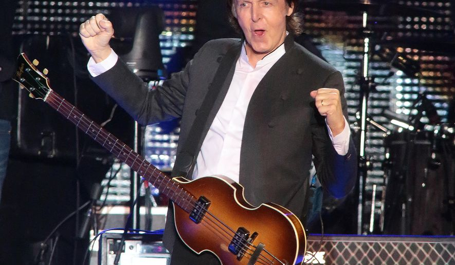 In this June 19, 2015 file photo, Paul McCartney performs on Day 2 of the 2015 Firefly Music Festival at The Woodlands  in Dover, Del. (Photo by Owen Sweeney/Invision/AP)