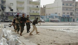 Security in Libya has reached a new low in recent weeks, and the dire situation made its way into Hillary Rodham Clinton's hearing Thursday before the House Select Committee on Benghazi. (Associated Press)