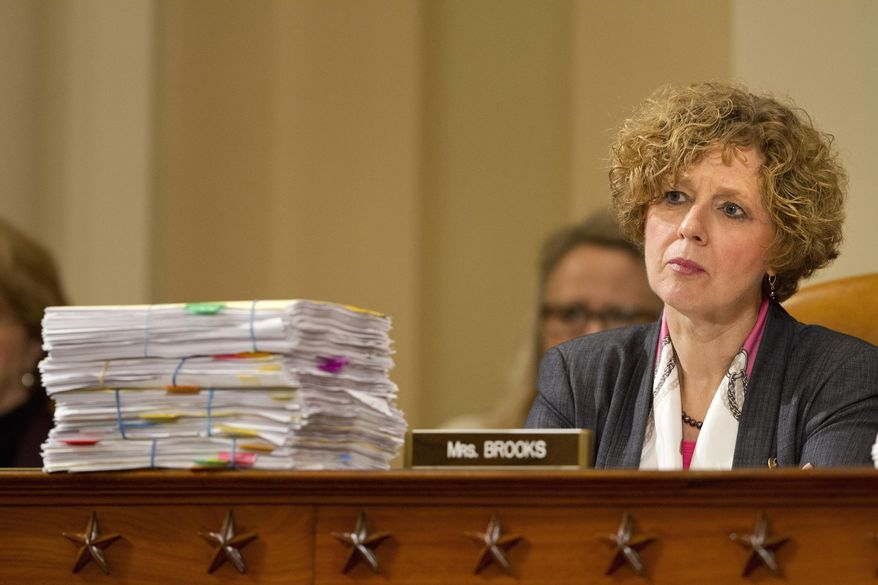 In this file photo, House Benghazi Committee member Rep. Susan W. Brooks, R-Ind., listens behind a stack of papers as Democratic presidential candidate, former Secretary of State Hillary Rodham Clinton, testifies on Capitol Hill in Washington, Thursday, Oct. 22, 2015, before the committee's hearing on Benghazi. (AP Photo/Jacquelyn Martin) **FILE**