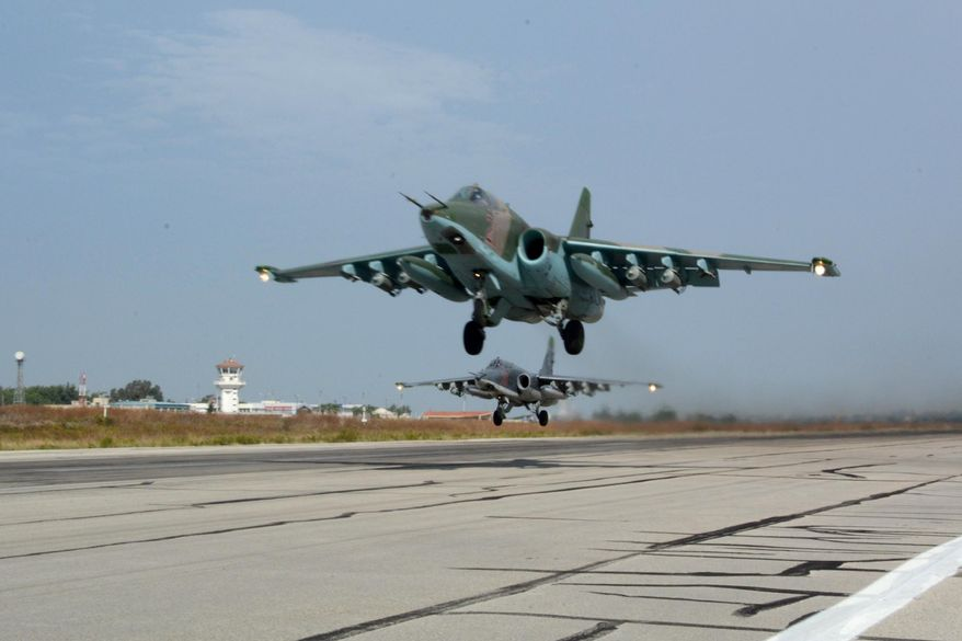 Russian Su-25 jets takes off for a mission from Hemeimeem airbase, Syria, on Thursday, Oct. 22, 2015. Since early morning, Russian combat jets have been taking off from this base in western Syria, heading for missions. (AP Photo/Vladimir Kondrashov) 2