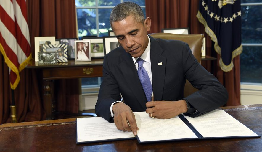President Barack Obama vetoes the National Defense Authorization Act (NDAA), Thursday, Oct. 22, 2015, in the Oval Office of the White House in Washington. The president vetoed the sweeping $612 billion defense policy bill, citing objections over how the measure is funded. (AP Photo/Susan Walsh)