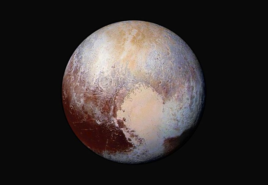 This image made available by NASA on Friday, July 24, 2015, shows a combination of images captured by the New Horizons spacecraft with enhanced colors to show differences in the composition and texture of Pluto's surface. The New Horizons was programmed to fire its thrusters Thursday, Oct. 22, 2015, putting it on track to fly past a recently discovered, less than 30-mile-wide object out on the solar system frontier. (NASA/JHUAPL/SwRI via AP)