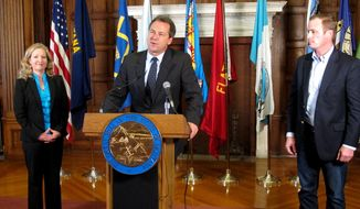 Montana Gov. Steve Bullock (center), Jamie Ryan Lockman (left) of Kamut International and Errol Rice of the Montana Stockgrowers Association discuss an upcoming trade mission to South Korea and Taiwan during a press conference in Helena on Oct. 22, 2015. (Associated Press) **FILE**