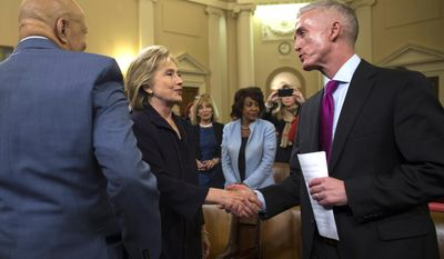 Democratic presidential candidate former Secretary of State Hillary Rodham Clinton shakes hands with House Select Committee on Benghazi chairman Rep. Trey Gowdy, R-S.C.,  at the conclusion of a hearing, on Capitol Hill on Thursday, Oct. 22, 2015, in Washington. At left with his back to the camera is Rep. Elijah Cummings, D-Md., ranking member on the committee. (AP Photo/Evan Vucci)