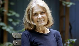 """In this Monday, Oct. 19, 2015, photo, Gloria Steinem poses for a picture at her home in New York. Steinem's latest book, """"My Life on the Road,"""" will be released on Oct. 27.  (AP Photo/Seth Wenig)"""