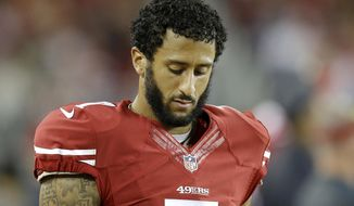 San Francisco 49ers quarterback Colin Kaepernick (7) stands on the sideline during the second half of an NFL football game against the Seattle Seahawks in Santa Clara, Calif., Thursday, Oct. 22, 2015. (AP Photo/Ben Margot)