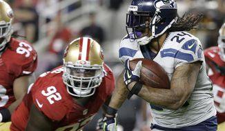 Seattle Seahawks running back Marshawn Lynch (24) runs against San Francisco 49ers defensive end Quinton Dial (92) during the second half of an NFL football game in Santa Clara, Calif., Thursday, Oct. 22, 2015. (AP Photo/Marcio Jose Sanchez) ** FILE **