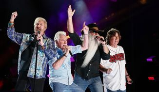 In this June 12, 2015, file photo, Duane Allen, from left, Joe Bonsall, William Lee Golden, and Richard Sterban of the Oak Ridge Boys perform at LP Field at the CMA Music Festival in Nashville, Tenn. On Sunday, Oct. 25, the Oak Ridge Boys will be inducted into the Country Music Hall of Fame. (Photo by Al Wagner/Invision/AP, File)