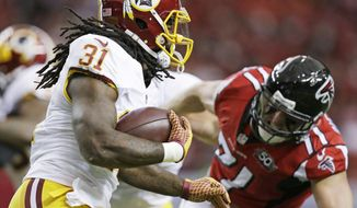Washington Redskins running back Matt Jones (31) runs against Atlanta Falcons outside linebacker Kroy Biermann (71) during the first half of an NFL football game, Sunday, Oct. 11, 2015, in Atlanta.(AP Photo/Brynn Anderson)