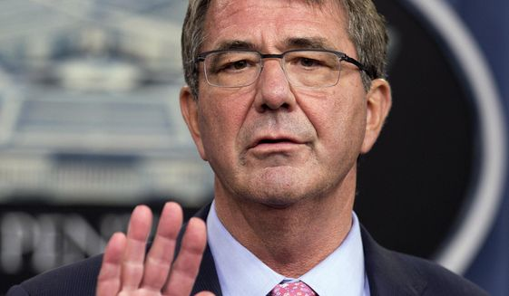 In this Sept. 30, 2015, photo Defense Secretary Ash Carter speaks to reporters during a news conference at the Pentagon. Carter says the American soldier killed in the mission that rescued 70 hostages from an Islamic State prison in Iraq was a hero for rushing into a firefight to defend his Kurdish partners, even though the plan called for the Kurds to do the fighting on their own. On Oct. 23, Carter applauded 39-year-old Army Master Sgt. Joshua L. Wheeler of Roland, Oklahoma, who died of his wounds Oct. 22. (AP Photo/Manuel Balce Ceneta, File)