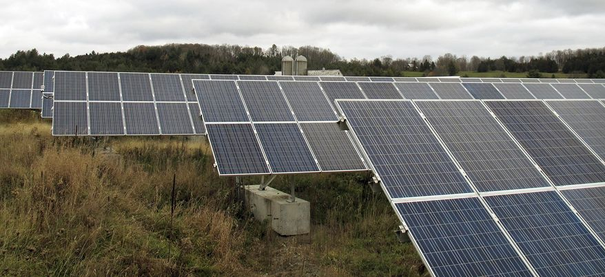 In this Friday Oct. 23, 2015 photo, solar panels that are part of a 100-kilowatt net metered project stand in a field on the McKnight Farm in East Montpelier, Vt. In 2014 Gov. Peter Shumlin signed a law at the farm which more than tripled the amount amount of electricity that can be sent to the electric grid from such projects. The amount of electricity being produced in the state by small net metered projects is growing faster than expected, and many utilities are nearing the cap established by the law.  (Photo/Wilson Ring)