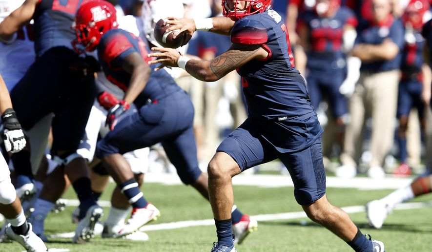 Arizona quarterback Anu Solomon scrambles against Washington State during the first half of an NCAA college football game, Saturday, Oct. 24, 2015, in Tucson, Ariz. (AP Photo/Rick Scuteri)