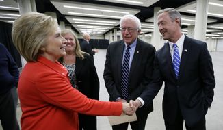 Democratic presidential candidates Hillary Rodham Clinton, left, Sen. Bernie Sanders, I-Vt., and former Maryland Gov. Martin O'Malley, right, talk backstage before the start of the Iowa Democratic Party's Jefferson-Jackson Dinner, Saturday, Oct. 24, 2015, in Des Moines, Iowa. (AP Photo/Charlie Neibergall) ** FILE **