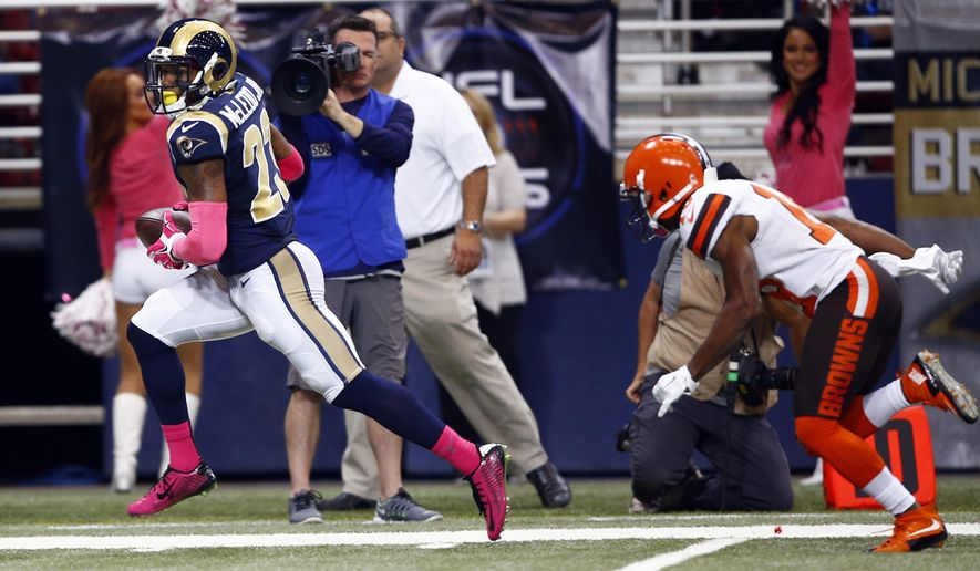 St. Louis Rams free safety Rodney McLeod, left, runs past Cleveland Browns wide receiver Taylor Gabriel after recovering a fumble by Gabriel and running it back for a touchdown during the first quarter of an NFL football game Sunday, Oct. 25, 2015, in St. Louis. (AP Photo/Billy Hurst)