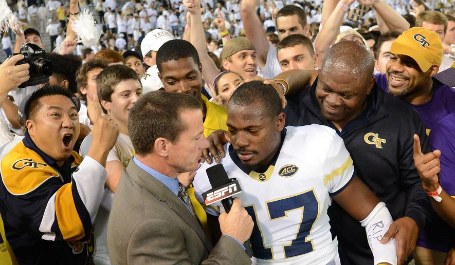Georgia Tech defensive back Lance Austin is interviewed by ESPN as fans cheer in the background after the second half of an NCAA college football game against Florida State, Saturday, Oct. 24, 2015, in Atlanta. Georgia Tech won 22-16. (AP Photo/Jon Barash)