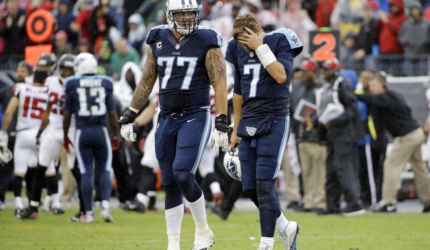 Tennessee Titans quarterback Zach Mettenberger (7) and tackle Taylor Lewan (77) walk to the sideline after the Atlanta Falcons' Robenson Therezie intercepted a pass to stop the Titans' final drive of the game in the fourth quarter of an NFL football game Sunday, Oct. 25, 2015, in Nashville, Tenn. The Falcons won 10-7. (AP Photo/James Kenney)