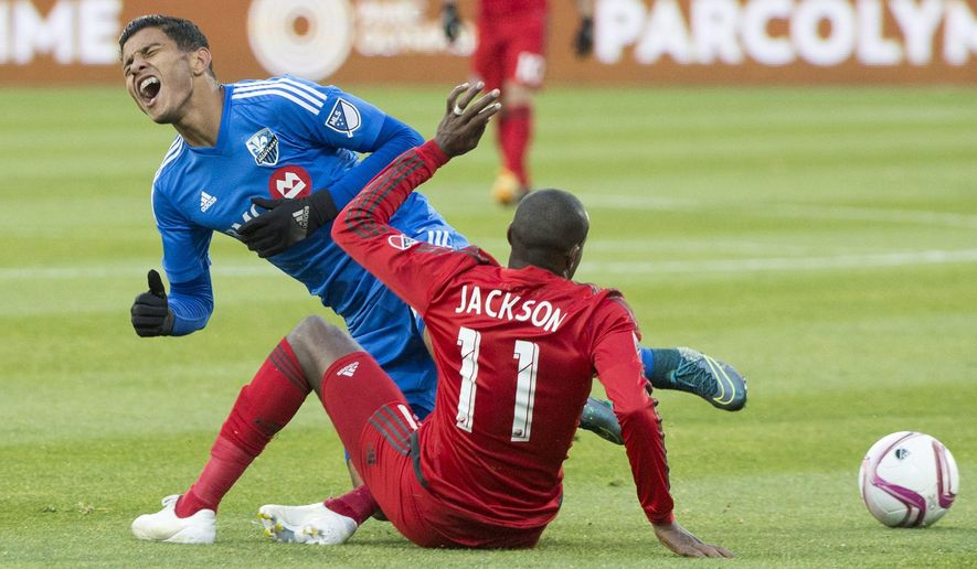 Montreal Impact's Johan Venegas, left, challenges Toronto FC's Jackson during first half MLS soccer action in Montreal, Sunday, Oct. 25, 2015. (Graham Hughes/The Canadian Press via AP)