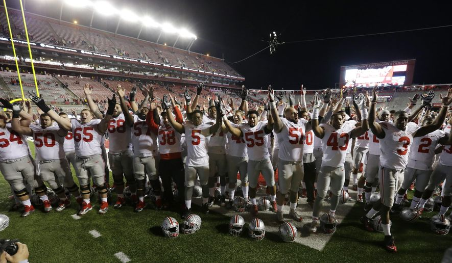 Ohio State players sing the alma mater on the field after an NCAA college football game against Rutgers, Saturday, Oct. 24, 2015, in Piscataway, N.J. Ohio State won 49-7. (AP Photo/Mel Evans)