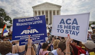 Supporters of the Affordable Care Act hold up signs as the opinion for health care is reported outside of the Supreme Court in Washington on June 25, 2015. (Associated Press) **FILE**