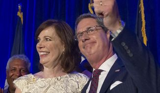 Republican Sen. David Vitter celebrates with wife, Wendy, after reaching a runoff with Democrat John Bel Edwards in the gubernatorial election, Saturday, Oct. 24, 2015, in Kenner, La. (Scott Threlkeld/The Advocate via AP) ** FILE **
