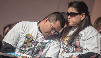 Alan Garcia, left, and his wife Veronica Garcia console each other during a candle light vigil for their daughter 4-year-old Lilly Garcia, who was killed earlier in the week during a road rage incident along Interstate 40, in Albuquerque, N.M., Saturday, Oct. 24, 2015. (Roberto E. Rosales/The Albuquerque Journal via AP)