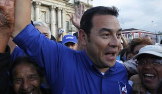 Jimmy Morales claimed victory and his opponent, former first lady Sandra Torres, conceded defeat after official results showed him winning around 69 percent of the votes, with 94 percent of polling stations tallied. (Associated Press)