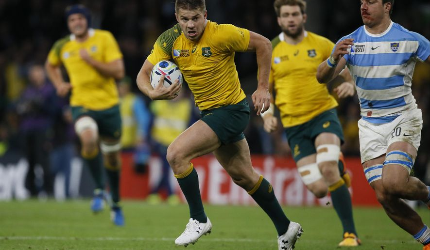 Australia's Drew Mitchell runs with the ball during the Rugby World Cup semifinal match between Argentina and Australia at Twickenham Stadium, London, Sunday, Oct. 25, 2015. (AP Photo/Kirsty Wigglesworth)