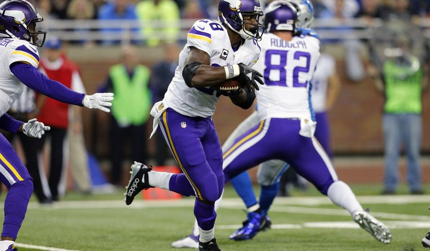 Minnesota Vikings quarterback Teddy Bridgewater, left, hands off to running back Adrian Peterson (28) during the first half of an NFL football game against the Detroit Lions, Sunday, Oct. 25, 2015, in Detroit. (AP Photo/Rick Osentoski)