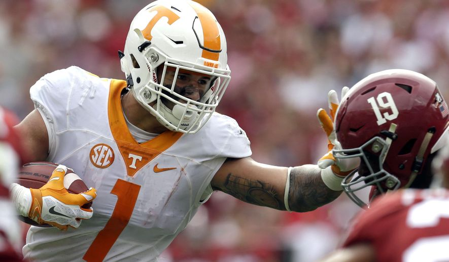 Tennessee running back Jalen Hurd (1) stiff arms Alabama linebacker Reggie Ragland (19) as he carries the ball during the first quarter of an NCAA college football game, Saturday, Oct. 23, 2015, in Tuscaloosa, Ala. (AP Photo/Butch Dill)