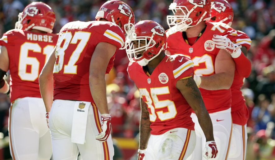 Kansas City Chiefs running back Charcandrick West (35) celebrates after scoring a touchdown during the second half of an NFL football game against the Pittsburgh Steelers in Kansas City, Mo., Sunday, Oct. 25, 2015. (AP Photo/Charlie Riedel)