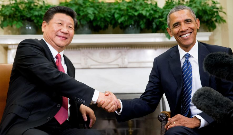 FILE - In this Sept. 25, 2015, file photo, U.S. President Barack Obama poses with Chinese President Xi Jinping for a photo during their meeting in the Oval Office of the White House in Washington, following a state arrival ceremony on the South Lawn. In the sometimes-testy rivalry between Washington and Beijing, good manners count. A recent amendment to a U.S.-China accord on safe encounters between their military pilots calls for keeping a secure distance, communicating clearly and keeping a lid on rude body language. The stipulation shows the degree to which the two sides hope to avoid unintended events, although there's no evidence that insulting behavior has been a factor in any recent encounters. (AP Photo/Andrew Harnik, File)