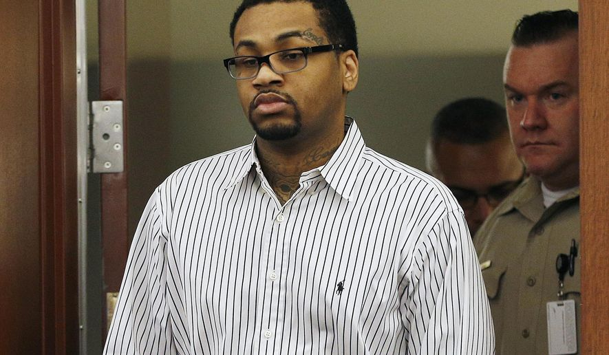 FILE - In this Monday, Oct. 12, 2015 file photo, Ammar Harris walks into court in Las Vegas. Harris was found guilty on Monday of killing three people in a shooting and fiery crash on the Las Vegas Strip in February 2013. Harris sat still and gave no reaction as the verdicts were read in Clark County District Court. (AP Photo/John Locher, File)